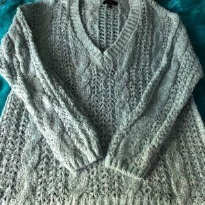 Tunic style V neck open knit sweater.